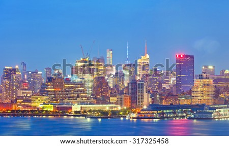 New York CIty, Manhattan famous landmarks at sunset - stock photo