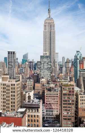 New York City Manhattan midtown aerial panorama view with skyscrapers and blue sky in the day - stock photo