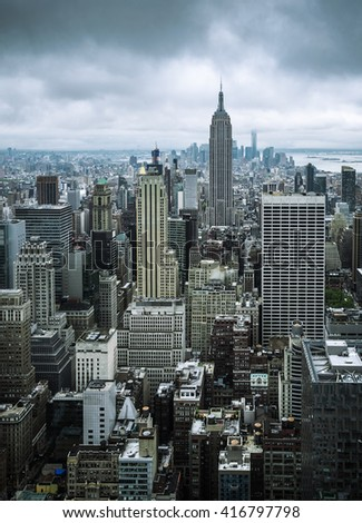 New York City Manhattan midtown aerial view with skyscrapers on an overcast day - stock photo