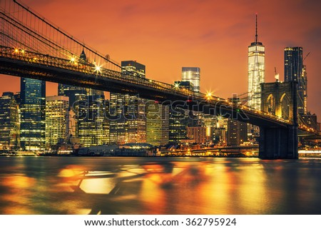 New York City Manhattan midtown at sunset with Brooklyn Bridge. - stock photo