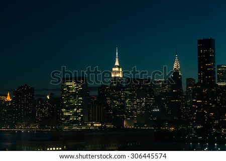 New York City Manhattan Midtown cityscape at night. - stock photo