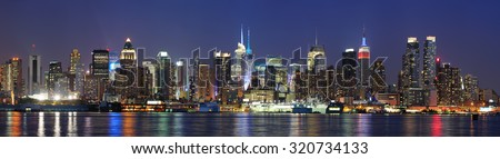 New York City Manhattan midtown skyline panorama at dusk with historical landmark skyscrapers over Hudson River viewed from New Jersey Weehawken waterfront.