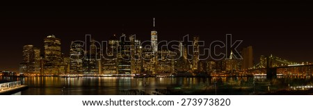 New York City Manhattan night panorama with Brooklyn bridge - stock photo