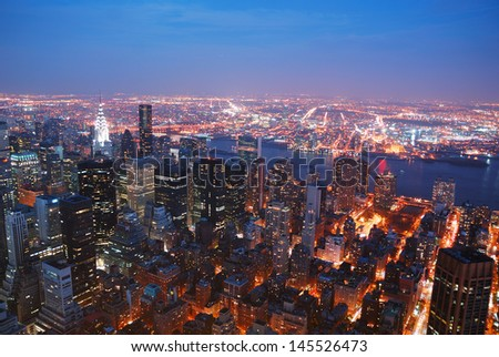 New York City Manhattan skyline aerial view panorama with Brooklyn and Hudson east river at sunset.