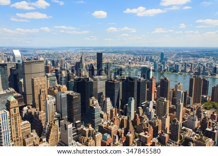 New York City Manhattan skyline aerial view with skyscrapers and Hudson.