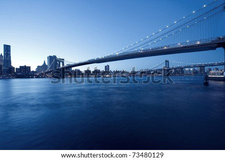 New York City Manhattan skyline and Brooklyn Bridge at dusk - stock photo