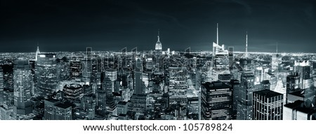 New York City Manhattan skyline at night panorama black and white with urban skyscrapers. - stock photo