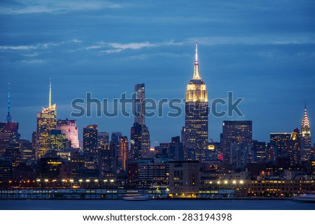 New York City Manhattan skyline over Hudson River viewed from New Jersey. - stock photo