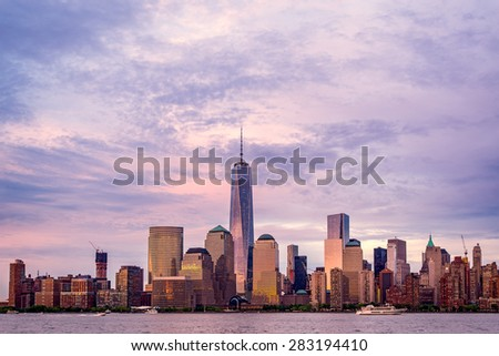 New York City Manhattan skyline over Hudson River viewed from New Jersey at sunset. - stock photo