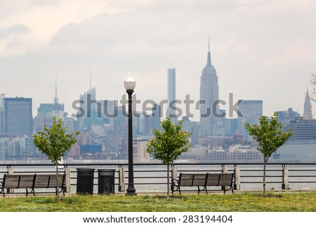 New York City Manhattan skyline over Hudson River viewed from New Jersey Liberty State Park at daytime. - stock photo