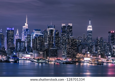 New York City Manhattan skyline panorama at night over Hudson River - stock photo