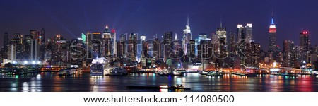 New York City Manhattan skyline panorama at night over Hudson River with refelctions viewed from New Jersey