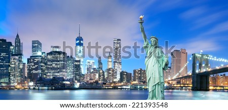 New York City - Manhattan Skyline with Brooklyn Bridge and the Statue of Liberty - stock photo