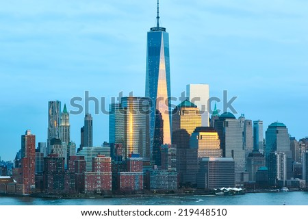 New York City Manhattan skyline with One World Trade Center Tower (AKA Freedom Tower) over Hudson River viewed from New Jersey - stock photo