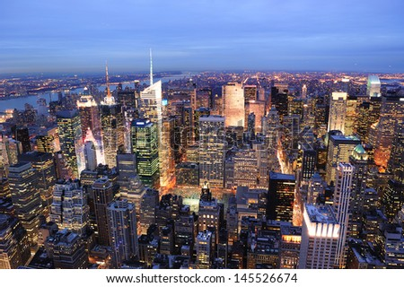 New York City Manhattan Times Square night city skyline aerial view with urban skyscraper illuminated. - stock photo