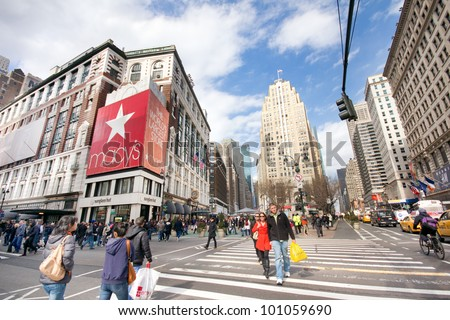 NEW YORK CITY - MAR. 9:  The bustle Herald Square in NYC as seen on Mar. 9, 2012.  This retail hub is named for now-defunct newspaper, the New York Herald and is a NYC iconic landmark. - stock photo