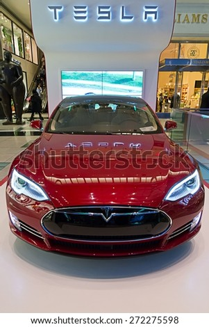 NEW YORK CITY, MAR 21: The new Tesla P85D on display at Columbus Circle in New York, New York on March 21, 2015. The electric powered vehicle is one of the fastest sedan in the world. - stock photo