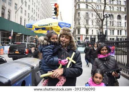 NEW YORK CITY - MARCH 20 2016: Clergy & parishioners of Trinity Church Wall St gathered at the St Paul's Chapel before proceeding along Broadway to Trinity Church for Palm Sunday.