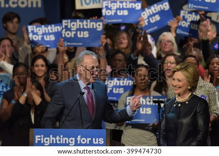 NEW YORK CITY - MARCH 29 2016: Democratic front runner Hillary Clinton appeared before supporters in Harlem's Apollo Theater to hear her address issues. Sen Charles Schumer introduces candidate
