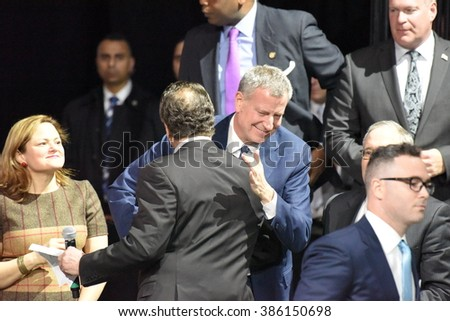 NEW YORK CITY - MARCH 2 2016: Hillary Clinton affirmed her status as front-runner for the Democratic presidential nominations with a speech at Jacob Javits Center. Bill de Blasio with Andrew Cuomo