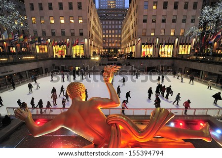 NEW YORK CITY - March. 2013: New York City landmark, Ice skaters and tourists on 2013. March. 2nd, visit Rockefeller Center ice skate rink - stock photo