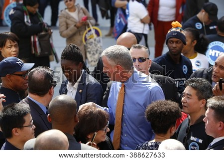 NEW YORK CITY - MARCH 9 2016: NYC mayor de Blasio rallied on the city hall steps with union and AARP members to urge passage of his affordable housing initiative. Mayor surrounded by supporters