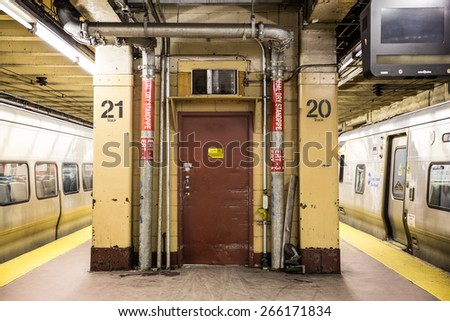 NEW YORK CITY - MARCH 13, 2015:  Scene with utility door and train from underground subway platform at Pennsylvania Station in Manhattan - stock photo