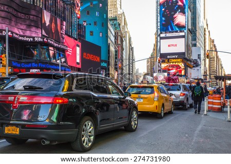 NEW YORK CITY - MARCH 23 2015:  Street scene along world famous Times Square at Broadway in midtown Manhattan.