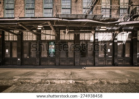 NEW YORK CITY - MARCH 13, 2015:  Street view from historic Gavsevoort Street of BFB Highline and The Raven restaurant and lounges from the Meatpacking District in Manhattan - stock photo