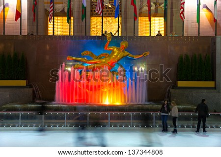 NEW YORK CITY - MARCH 31: The golden Prometheus statue at the Rockefeller center on March 31, 2012 in New York, NY. This bronze gilded statue is located at the front of 30 Rockefeller Plaza - stock photo