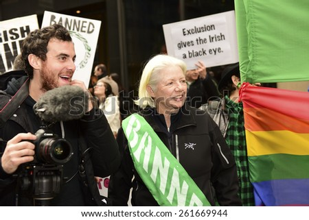 NEW YORK CITY - MARCH 17 2015: the 254th St. Patrick's Day parade, led by grand marshal Timothy Cardinal Dolan, filled Fifth Avenue in Midtown in spite of protests from the Irish Queers organization - stock photo