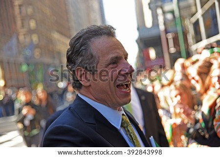 NEW YORK CITY - MARCH 17 2016: Thousands lined 5th Ave to witness Mayor de Blasio march for the first time in the nation's largest St Patrick's Day parade. NY governor Andrew Cuomo leads parade - stock photo