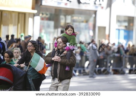 NEW YORK CITY - MARCH 17 2016: Thousands lined 5th Ave to witness Mayor de Blasio's first march in the nation's oldest & largest St Patrick's Day parade.