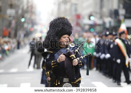 NEW YORK CITY - MARCH 17 2016: Thousands lined 5th Ave to witness Mayor de Blasio's first march in the nation's oldest & largest St Patrick's Day parade. Drum major with bearskin & baton.