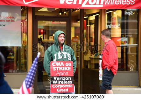 NEW YORK CITY - MAY 15 2016: A dozen striking CWA workers maintain a constant picket against a Verizon store on Montague Street in Brooklyn Heights