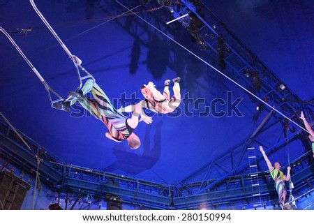 "NEW YORK CITY - MAY 17 2015: Big Apple Circus closed out its season in Cunningham Park, Queens, with a show called ""Metamorphosis"". Members of the Anaskin Troupe - stock photo"