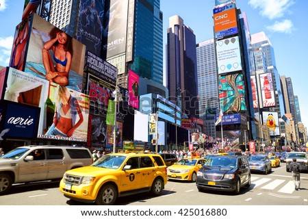 NEW YORK CITY - MAY 08: Cars and taxi cabs at 7th Avenue and Broadway in Times Square with crowds of people and lots of advertising on May 08, 2016 in New York, NY, USA.