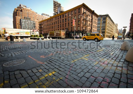 NEW YORK CITY - MAY 23: Cobblestone intersection in historic New York City meatpacking district on May 23, 2012.  This trendy neighborhood was once a predominate meat distribution center. - stock photo
