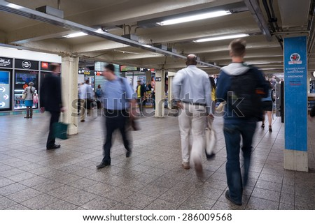 NEW YORK CITY - MAY 2015: Commuters in Times Square subway station. The NYC Subway is one of the oldest and most extensive public transportation systems in the world, with 468 stations.  - stock photo