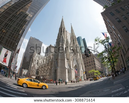 NEW YORK CITY - MAY 11, 2015: Famous St. Patrick church front view in manhattan with yellow taxi in the street. - stock photo
