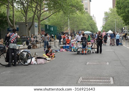 NEW YORK CITY - MAY 16, 2015: Flea market on the street. A flea market (or swap meet) is a type of bazaar that rents space to people who want to sell or barter merchandise and used goods.