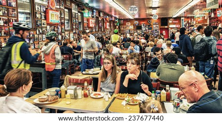 NEW YORK CITY - MAY 25, 2013: Katz's Delicatessen full of tourists and locals in Manhattan.Since its founding in 1888, it has become popular among locals and tourists alike for its pastrami sandwiches - stock photo