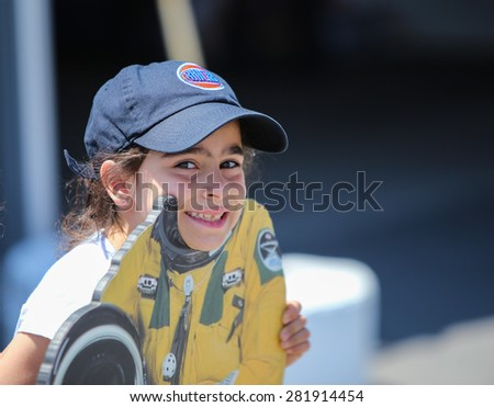 NEW YORK CITY - 25 MAY 2015: Mayor Bill de Blasio & Gen John Kelly presided over Memorial Day observances on Pier 86 by the USS Intrepid. Kids pose in astronaut cut-out on Pier 86 - stock photo