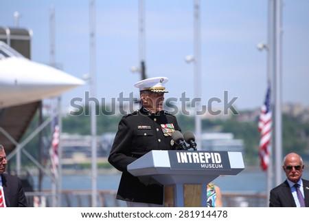 NEW YORK CITY - 25 MAY 2015: Mayor Bill de Blasio & Gen John Kelly presided over Memorial Day observances on Pier 86 by the USS Intrepid. General John Kelly, USMC, speaks - stock photo