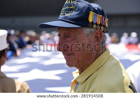 NEW YORK CITY - 25 MAY 2015: Mayor Bill de Blasio & Gen John Kelly presided over Memorial Day observances on Pier 86 by the USS Intrepid. World War two veteran with flag background - stock photo