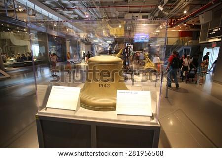 NEW YORK CITY - 25 MAY 2015: Mayor Bill de Blasio & Gen John Kelly presided over Memorial Day observances on Pier 86 by the USS Intrepid. Original brass bell from USS Intrepid. - stock photo