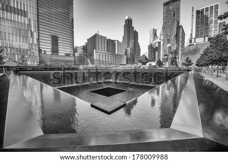 NEW YORK CITY - MAY 21: 9/11 Memorial geometric architecture and buildings, May 21, 2013 in New York City. The Memorial honors people killed in the terror attacks of September 11, 2001 - stock photo