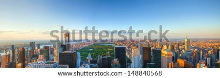 NEW YORK CITY - MAY 13: New York City panorama with Central park at sunset on May 13, 2013 in New York. Central Park is a public park at the center of Manhattan which was initially opened in 1857. - stock photo