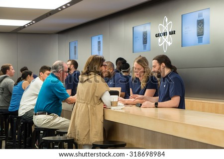 NEW YORK CITY - MAY 13, 2015: People at Genius Bar inside Apple store. As of 2014, Apple employs 72,800 permanent full-time employees, maintains 437 retail stores in fifteen countries.  - stock photo
