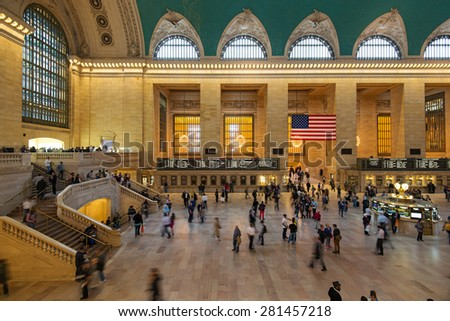 NEW YORK CITY - MAY 2015: People rushing inside the Main hall of Grand Central Station. The terminal is the largest train station in the world by number of platforms having 44. - stock photo
